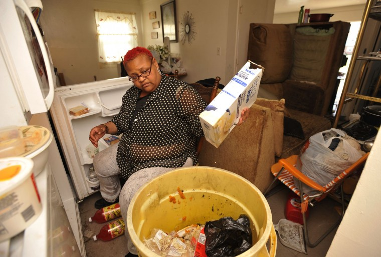 Kisha Jones, Somers Cove Apartments, empties her refrigerator of food after losing power when Superstorm Sandy struck. Her apartment was flooded with several inches of water. (Kim Hairston/Baltimore Sun)