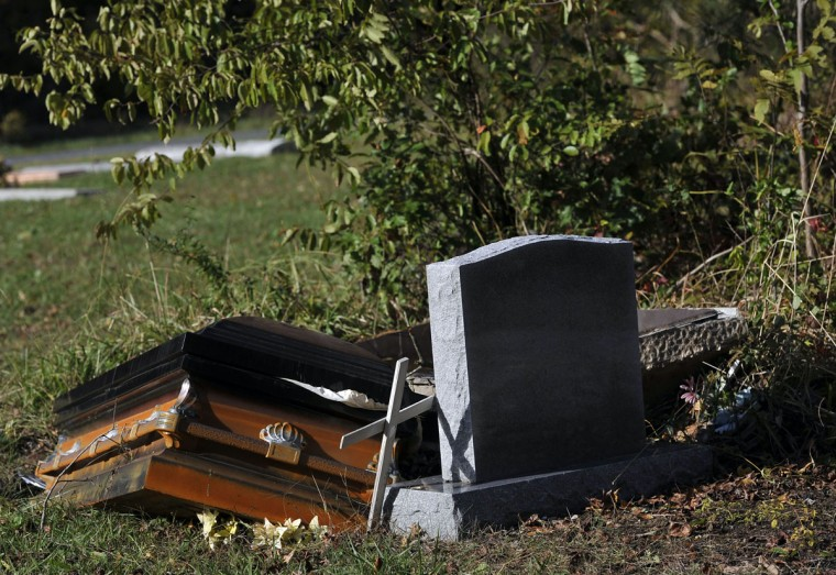 Superstorm Sandy forced caskets above ground in the cemetery on Halls Creek Road. (Kim Hairston/Baltimore Sun)