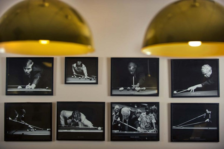 Classic photographs of professional pool players decorate the wall behind the pool table at Joss Cues. Joss cues have been used by a number of legendary professionals including the famous Minnesota Fats. (Karl Merton Ferron/Baltimore Sun)