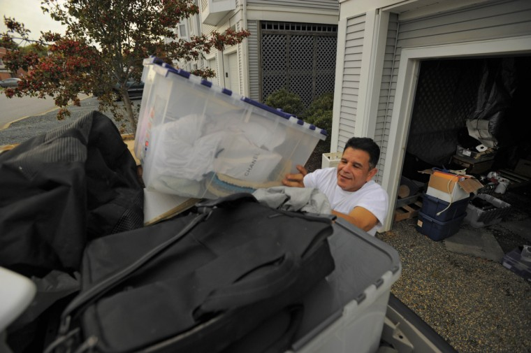 Working since 5 o'clock this morning, Joe Garcia, who suffered a loss from the heavy rains last summer, gets help moving belongings into a storage facility on high ground with his girlfriend Gina Benavidez, visiting from New Mexico at the Havre de Grace community of Canvas Back Cove. (Karl Merton Ferron/Baltimore Sun)