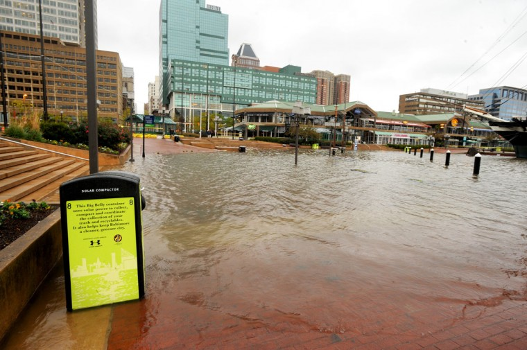 October 30, 2012: The promenade at Baltimore's Inner Harbor is flooded at high tide with help from the winds of Hurricane Sandy. (Jerry Jackson/Baltimore Sun)