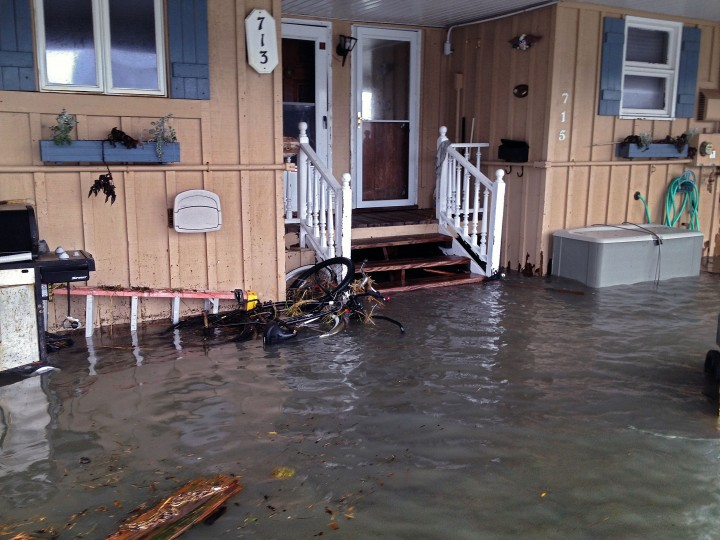 A home is surrounded by a tidal surge from the bay. (Karl Merton Ferron / Baltimore Sun)