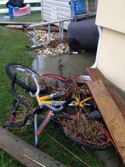 Children's bikes are covered with debris. (Karl Merton Ferron / Baltimore Sun)