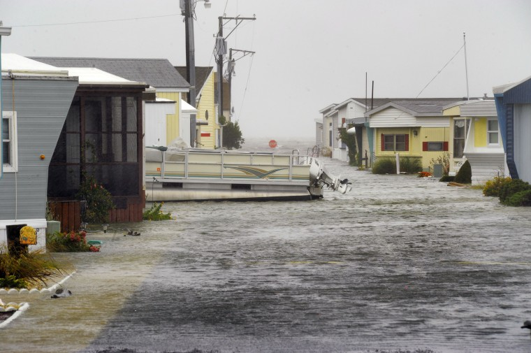 A pontoon boat floats on Middle Way Drive in a mobile home community off Coastal Highway as Hurricane Sandy floods the eastern shore resort community. (Karl Merton Ferron / Baltimore Sun)