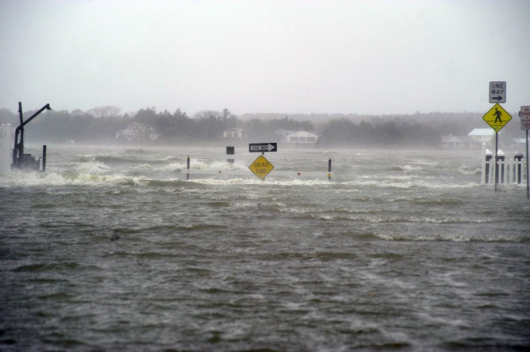 October 29, 2012: The waters of the entrance of Isle of Wight Bay overwhelm Bayview Edgewater Avenue in Ocean City looking west at the dead end of 8th Street (homes across the bay are West O.C.) as Hurricane Sandy floods the eastern shore resort community Monday. (Karl Merton Ferron/Baltimore Sun)