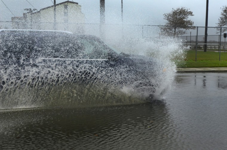 An SUV makes a splash on 4th Street at Edgewater Ave, through rising water from the effects of Hurricane Sandy that are affecting the east coast Sunday, Oct 28, 2012. Sandy, still hundreds of miles from Ocean City, has yet to actually impact the mid-Atlantic states. (Karl Merton Ferron/Baltimore Sun )