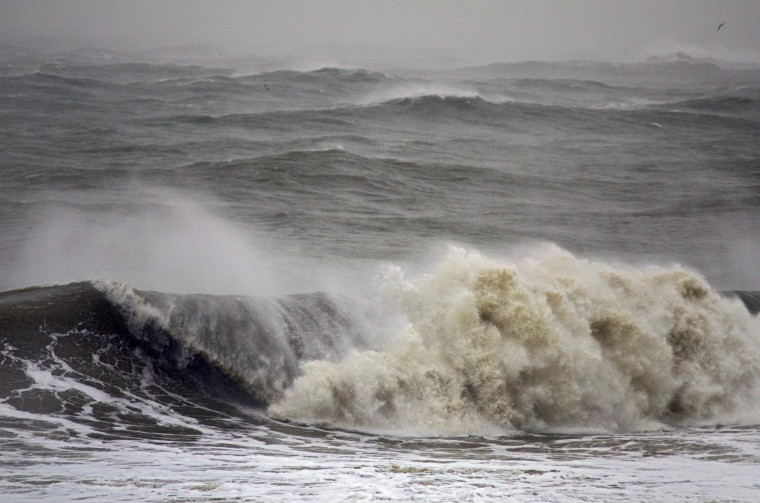Waves much higher than normal break as they head towards the beach. (Karl Merton Ferron / Baltimore Sun)