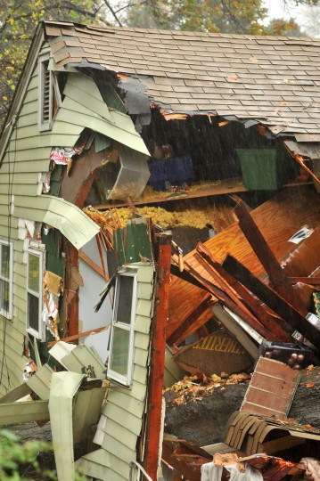 A Home at 420 W.Maple Avenue in Linthicum was crushed by a tree during Hurricane Sandy. (Amy Davis/Baltimore Sun)