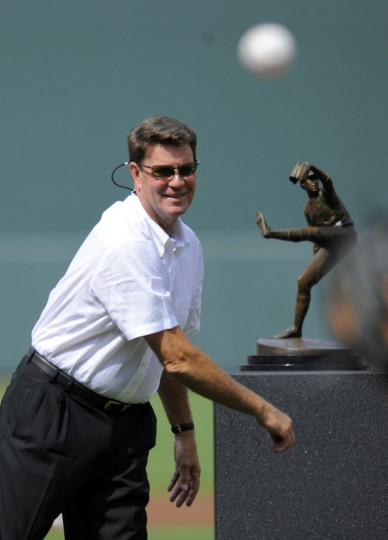 Jim Palmer throws out the first pitch, near his miniature sculpture at Camden Yards on July 14, 2012. (Lloyd Fox/Baltimore Sun)