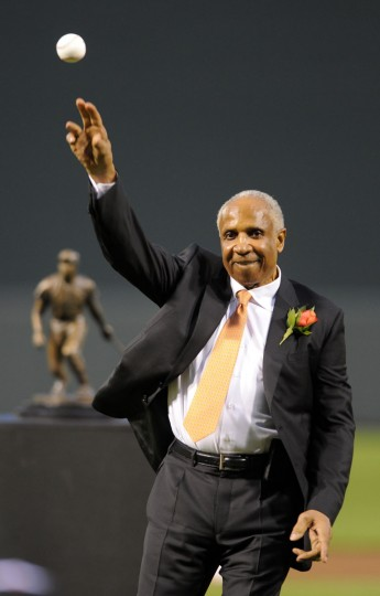 Oriole Hall of Famer Frank Robinson throws out the first pitch before the Orioles vs. A's game. The Baltimore Orioles honored Hall of Famer Frank Robinson by unveiling a Frank Robinson statue at Oriole Park at Camden Yards. (Lloyd Fox/Baltimore Sun)