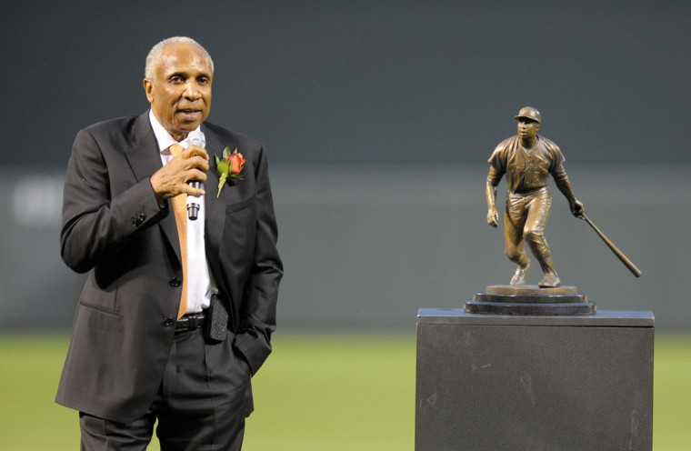 Hall of Famer Frank Robinson says a few words after a small statue was unveiled on the field before the Orioles-Athletics game on April 28, 2012. (Lloyd Fox/Baltimore Sun)
