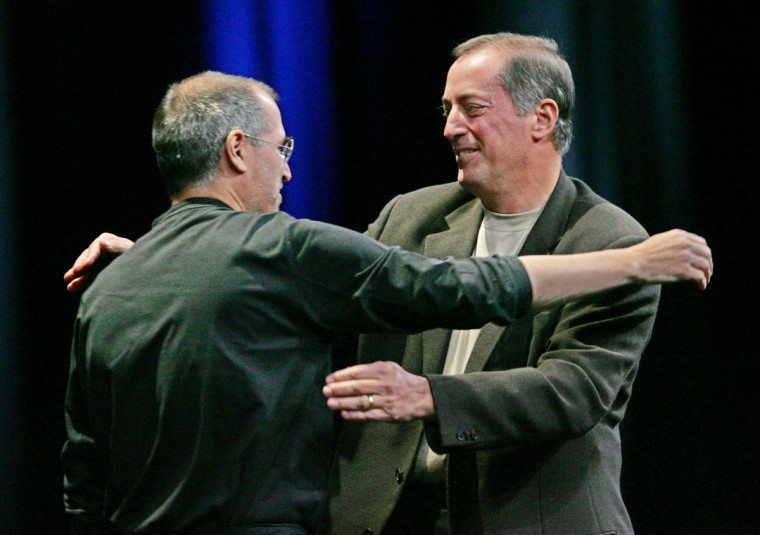 June 6, 2005: Apple Computer Inc. CEO Steve Jobs, left, hugs Intel Corp. CEO Paul Otellini, right, at Apples Worldwide Developers Conference in San Francisco, California. Apple announced it will discontinue using microprocessor chips made by IBM in favor of Intel chips. (Paul Sakuma/AP Photo)