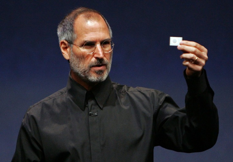 September 12, 2006: Apple CEO Steve Jobs holds up a new iPod Shuffle as he delivers a keynote address during an Apple media event in San Francisco, California. (Justin Sullivan/Getty Images)