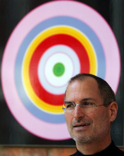 April 2, 2007: Apple computer CEO Steve Jobs looks on in the lobby of the EMI record company headquarters in London. Jobs was at the launch of digital rights management (DRM) free recordings that EMI will make available on the Apple ITunes website from May 2007. Apple will be the first online store to offer this service. (Alastair Grant/AP Photo)