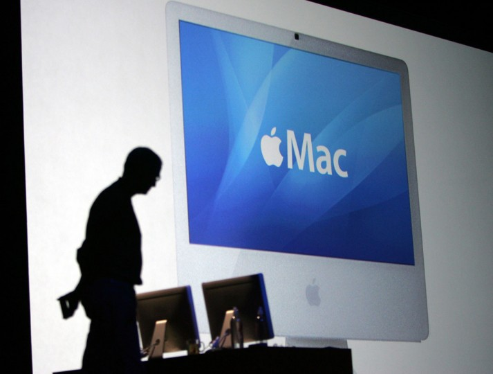 January 10, 2006: Apple Computer, Inc. CEO Steve Jobs is silhouetted in front of an Apple iMac powered by an Intel Corp. processor at the MacWorld conference in a San Francisco file photo. (Paul Sakuma/AP Photo)