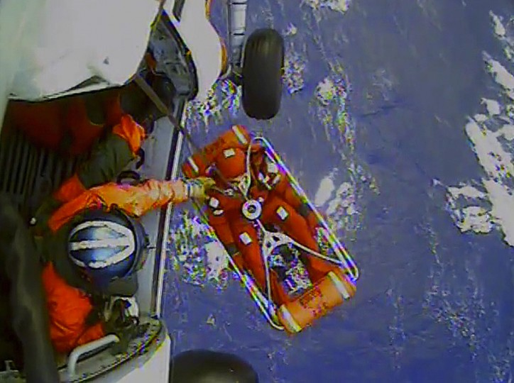 A frame from a video shows a crew member of the HMS Bounty being lifted to a Coast Guard rescue helicopter in a rescue basket Monday, October 29, 2012, 90 miles southeast of Cape Hatteras, North Carolina. The Coast Guard rescued 14 people from life rafts after the ship went down in the rough seas of Hurricane Sandy. (Coast Guard via Raleigh News & Observer/MCT)