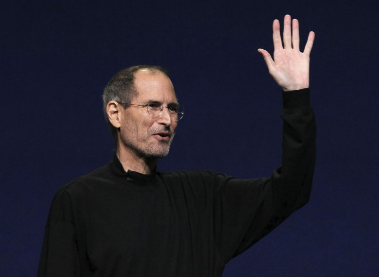 March 2, 2011: Apple CEO Steve Jobs waves to the crowd after speaking during an Apple Special event to unveil the new iPad 2 at the Yerba Buena Center for the Arts in San Francisco, California. (Justin Sullivan/Getty Images)