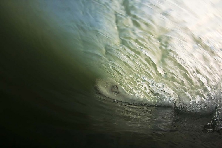 Surfer Evan Griffiths gets swallowed in a barrel while surfing the waves created by Hurricane Leslie. (Credit: Nick Denny)