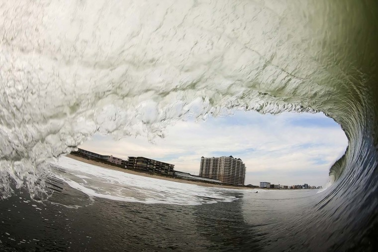 A view from the inside of a wave looking out with Ocean City in the background. Denny said he actually got sucked over and thrown around a good bit with this wave. (Credit: Nick Denny)