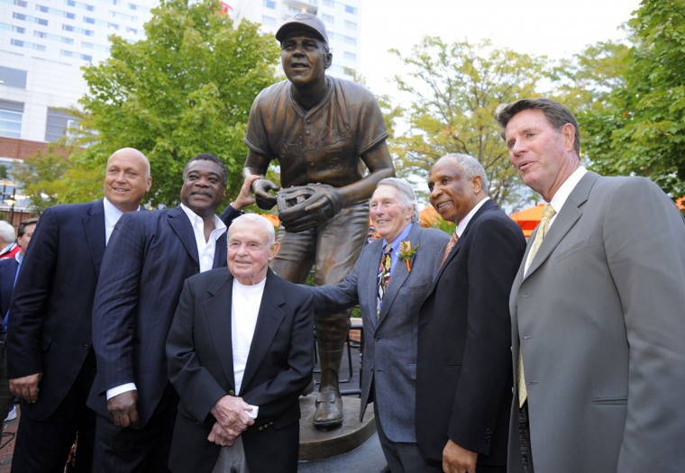 From left, Orioles Hall of Famers Cal Ripken Jr., Eddie Murray, Earl Weaver, Brooks Robinson, Frank Robinson and Jim Palmer stand together outside Camden Yards as Brooks Robinson's sculpture is unveiled (Lloyd Fox/Baltimore Sun Photo)
