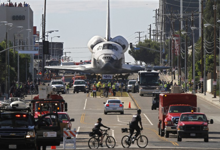 People line the street to look at the space shuttle Endeavour as it makes its way through Los Angles, California, on the way to a museum . (Don Bartletti/Los Angeles Times)