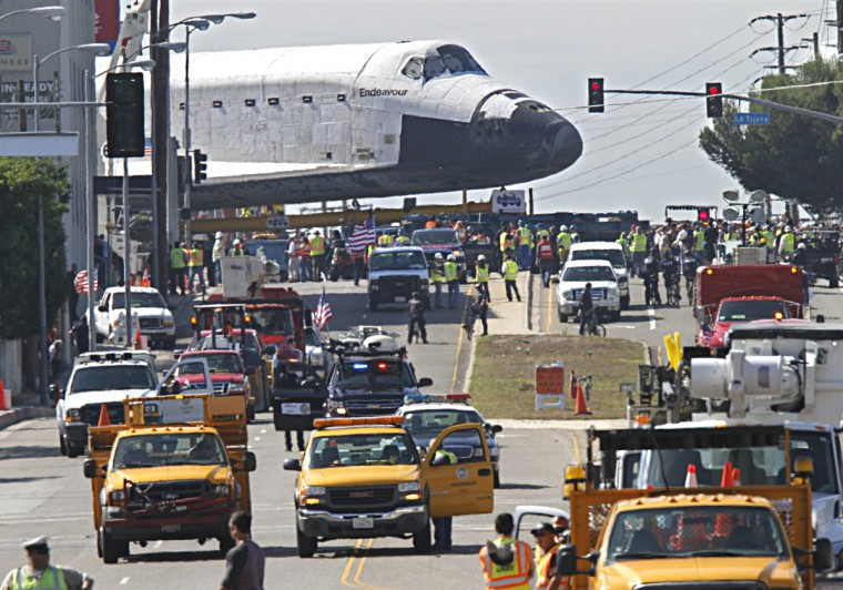 People line the street to look at the space shuttle Endeavour as it makes its way through Los Angles, California, on the way to a museum. (Don Bartletti/Los Angeles Times)