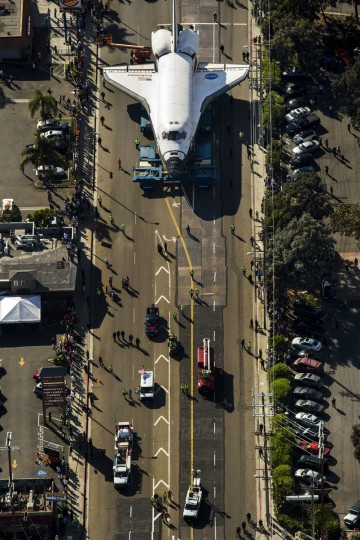 People line the street to look at the space shuttle Endeavour as it makes its way through Los Angles, California, on the way to a museum. (Jay L. Clendenin/Los Angeles Times)