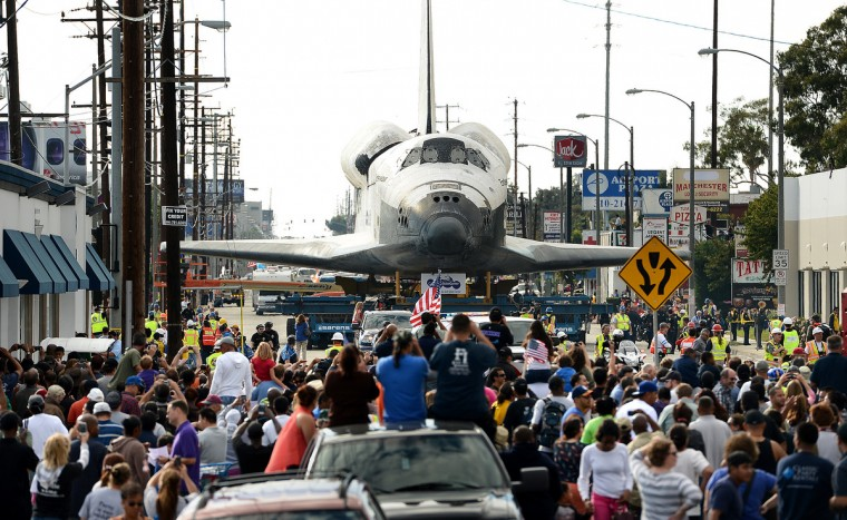 People line the street to look at the space shuttle Endeavour as it makes its way through Los Angles, California, on the way to a museum. (Wally Skalij/Los Angeles Times)