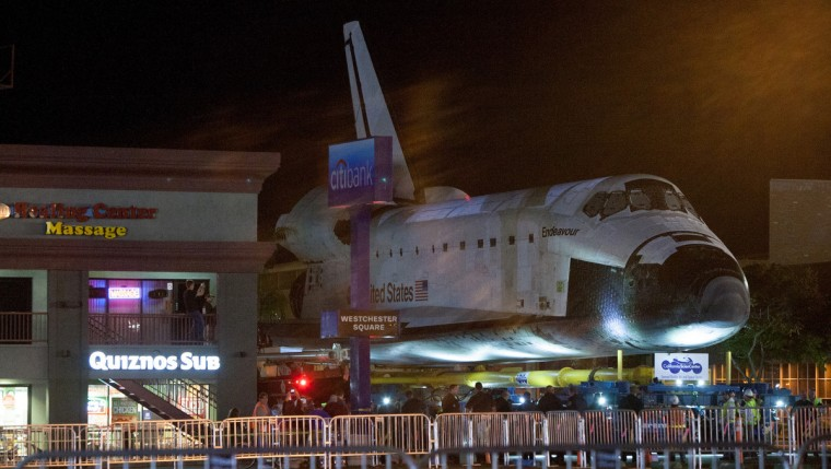 The space shuttle Endeavour arrives at a parking lot along La Tijera Blvd. in Westchester, California. (Bryan Chan/Los Angeles Times)