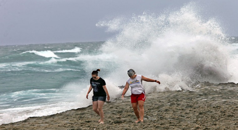 October 25, 2012: Micki Fetterman, right, of North Palm Beach, said she and her daughter Kasi decided to 'make great use of an afternoon off' to look for sea glass and enjoy the weather on the beach north of Ocean Reef Park on Singer Island. (Lannis Waters/Palm Beach Post/MCT)