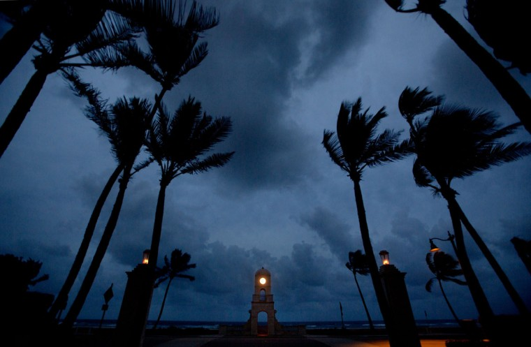 October 25, 2012: Clouds darken the sky behind the Worth Avenue clock tower shortly before dawn Thursday in Palm Beach, Florida. (Lannis Waters/Palm Beach Post/MCT)