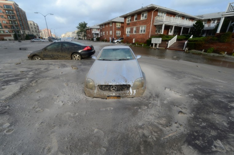 October 30, 2012: Two cars are abandoned in the sand from the aftermath of hurricane Sandy in Long Beach, New York, Tuesday. (Alejandra Villa/Newsday/MCT)