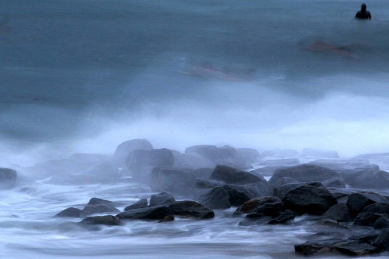 October 25, 2012: A surfer waits for a wave off Boynton Inlet Park in Boynton, Florida, on Thursday. (Allen Eyestone/Palm Beach Post/MCT)