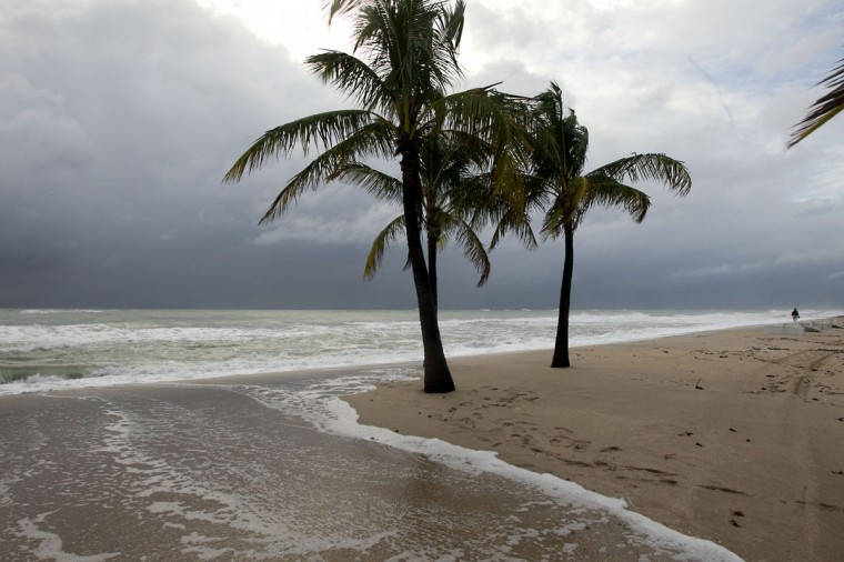 October 26, 2012: Waves wash over the beach at A1A and Sunrise Blvd. from the high tides and wind driven waves on Ft. Lauderdale Beach, Friday. (Joe Rimkus Jr./Miami Herald/MCT)