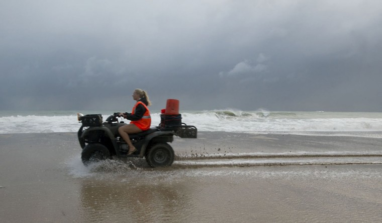 October 26, 2012: Turtle patrol ATV drives across flooded beach at Sunrise Blvd caused by high tides and wind driven waves on Ft. Lauderdale Beach, Florida. (Joe Rimkus Jr./Miami Herald/MCT)