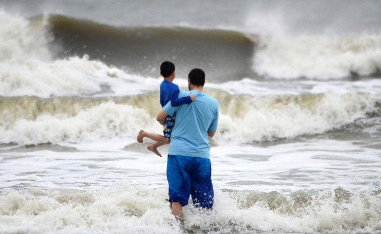Beachgoers watch as waves generated by HurricaneSandy crash ashore at Coligny Beach on South Carolina's Hilton Head Island. (Jay Karr/The Island Packet/MCT)