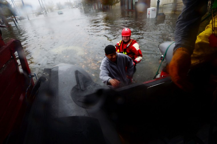 October 29, 2012: Members of the Atlantic Beach Rescue Department pick up a stranded pedestrian in Island Park because of flooding due to Hurricane Sandy on Monday. (Alejandra Villa/Newsday/MCT)