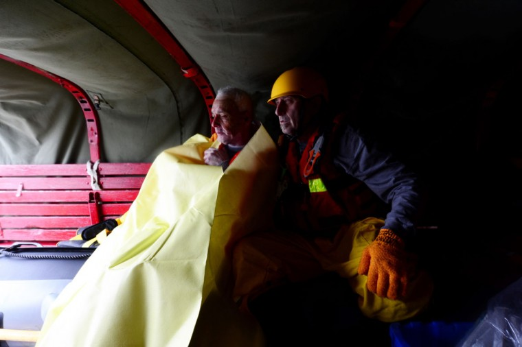 October 29, 2012: Island Park resident Ernesto Elves warms up next to Steven Pelman of the Atlantic Beach Rescue Department, Monday after he was rescued from a flooded zone due to Hurricane Sandy. (Alejandra Villa/Newsday/MCT)