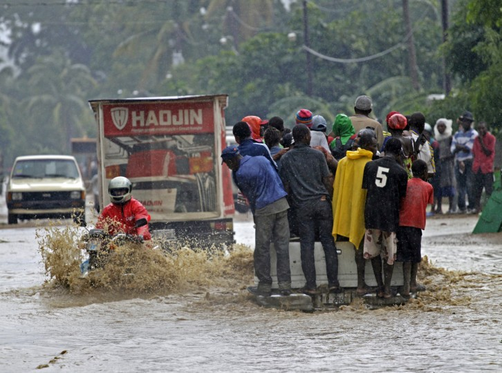 A motorcyclist rides through a flooded street in Petit Goave, Haiti, where three overflowing rivers created havoc burying homes and farms under water, on Friday. The rural community, south of Port-au-Prince, suffered rains caused by Hurricane Sandy. (Carl Juste/Miami Herald/MCT)