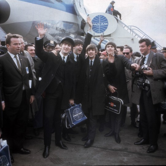 The Beatles arrive at New York's Kennedy Airport Feb. 7, 1964 for their first U.S. appearance. From left are: John Lennon, Paul McCartney, Ringo Starr and George Harrison. Just after 1 p.m. on Feb. 7, 1964, a Pan Am flight from London landed at New York's Idlewild airport. It was carrying a revolution, in the shape of four shaggy-haired musicians from Liverpool. Over the next two weeks The Beatles stormed America, appearing three times on ``The Ed Sullivan Show'' and playing concerts in front of thousands of fervid fans. By the time they flew home, the Fab Four were the most famous band in the world, and the nature of celebrity had changed forever. (AP Photo)