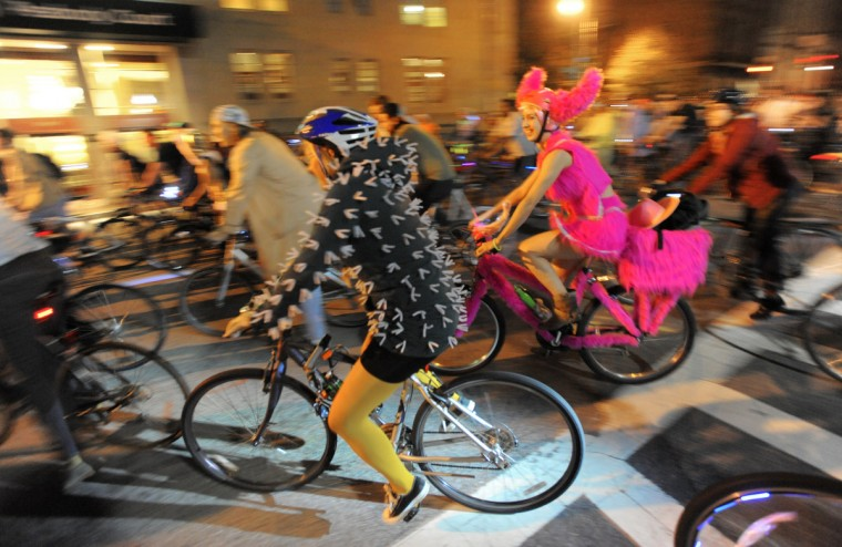 Cyclists participate in Bike Party Halloween Brew-ha-ha starting in Mount Vernon and ending in Hampden Friday night. (Jerry Jackson/Baltimore Sun)