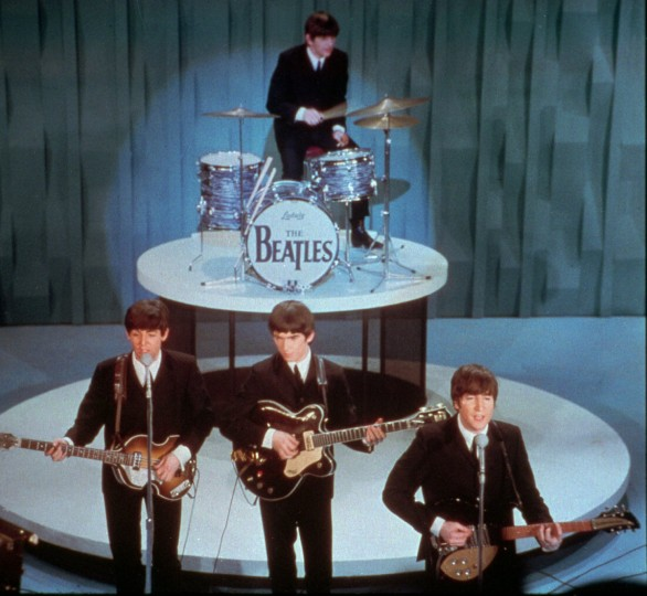"The Beatles performed on the ""Ed Sullivan Show"" in New York on Feb. 9, 1964. Front row, from left; Paul McCartney, George Harrison and John Lennon. Drummer Ringo Starr is at rear. (AP Photo)"