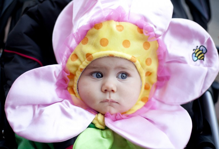 Isabella Johnson of Laurel takes in the scene during her first Halloween celebration at the annual Trick or Treat on Main Street event on October 25. (Sarah Pastrana/Patuxent Publishing)