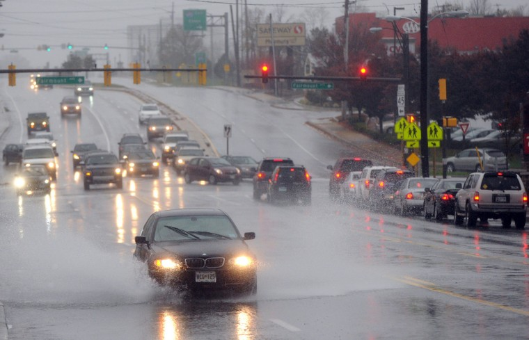 A car passes through a puddle on York Road in Towson as the effects of Hurricane Sandy were felt in and around Towson, Md., on Monday. (Brian Krista/Patuxent Homestead)