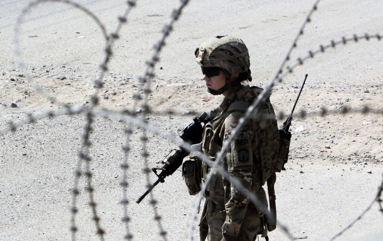 U.S. army soldier SGT Jessica Corona of Task Force Lancer, 563 Military Police Company stands guard at a joint U.S.-Afghan military checkpoint in Kandahar city, southern Afghanistan. (Erik De Castro/Reuters)