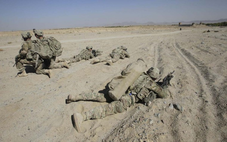 U.S. Army soldiers of 2nd Battalion, 1st Infantry Regiment, take up positions during a joint U.S.-Afghan military patrol in Arghandab Valley in Kandahar province, southern Afghanistan October 22, 2012. (Erik De Castro/Reuters)