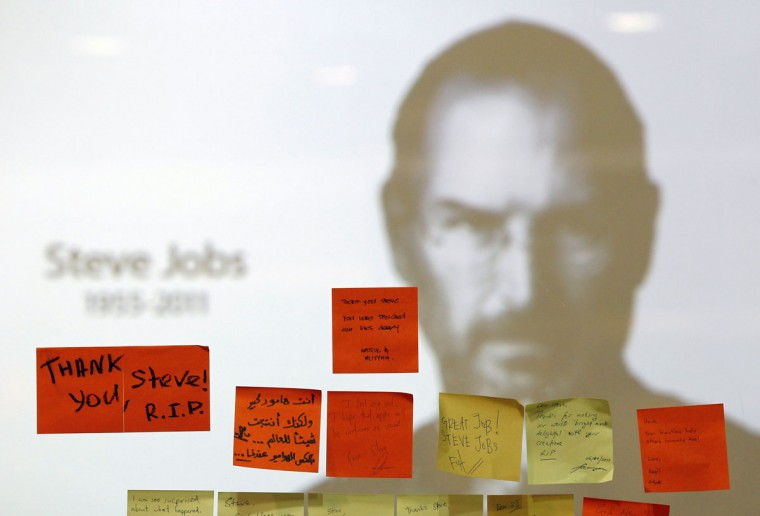 October 7, 2011: Tributes to the late Steve Jobs are posted at an Apple Store in Kuala Lumpur. (Bazuki Muhammad/Reuters)