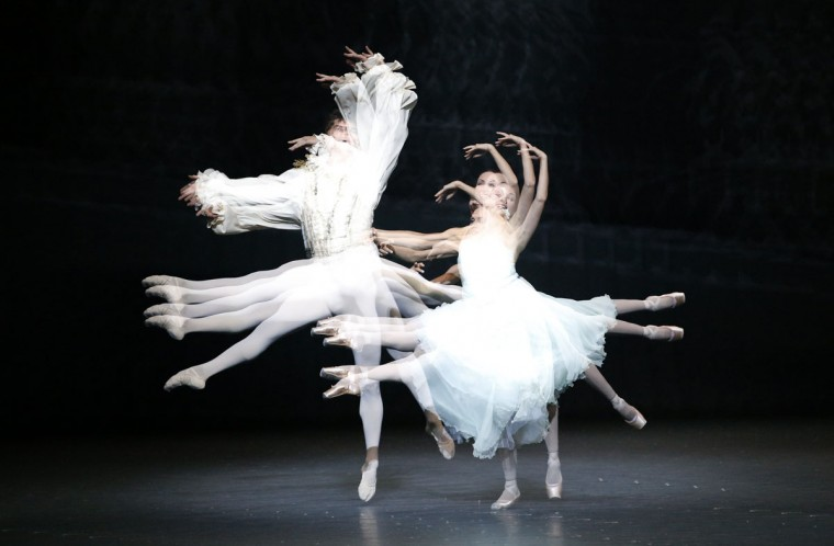 "Dancers of the opera ballet perform during the dress rehearsal of Peter Ilyich Tchaikovsky's ""The Nutcracker"" (Der Nussknacker) at the state opera in Vienna in this multi-exposure photo. The ballet is directed by Manuel Legris and will premiere October 7, 2012. (Leonhard Foeger/Reuters)"