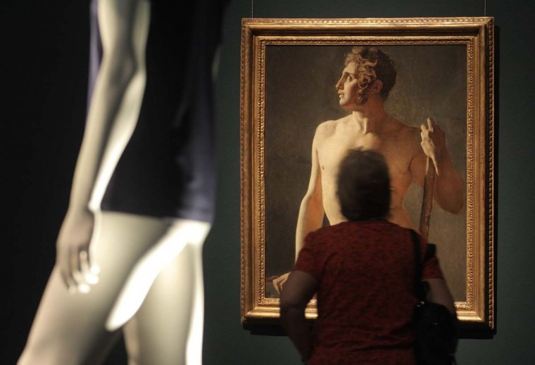 A visitor looks at the painting 'Male Torso' by French painter Jean Auguste Dominique Ingres during a preview of the art exhibition 'Nude Men' at the Leopold museum in Vienna October 18, 2012. The exhibition of around 300 art works, which runs until January 28, 2013, is designed to show how the depiction of male nudity has evolved in art history. (Heinz-Peter Bader/Reuters)