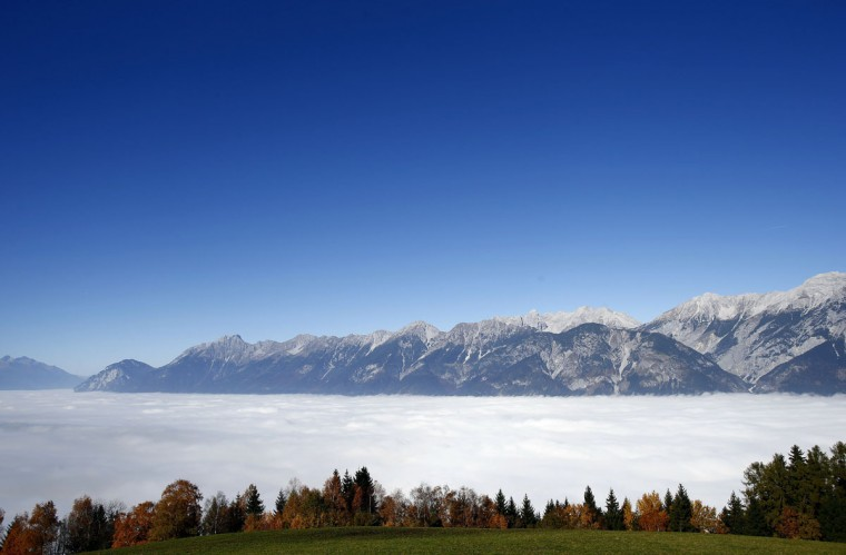 Fog covers the Inntal valley as the famous Nordkette mountains are seen on a sunny autumn day in the western Austrian province of Tyrol. (Dominic Ebenbichler/Reuters)
